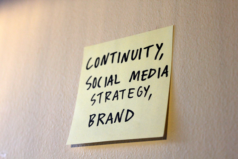 Post-it note of our keypoints; continuity, social media strategy, brand